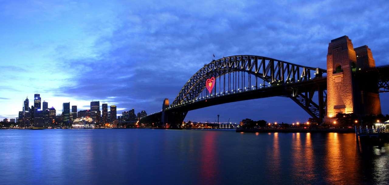 Widok na centrum Sydney (Australia) - Najważniejszymi obiektami, a zarazem głównymi symbolami Sydney, są wybudowana przez Jørna Utzona opera (Sydney Opera House), starówka nazywana Skałami, wielki ogród botaniczny oraz nowoczesne (10×5)