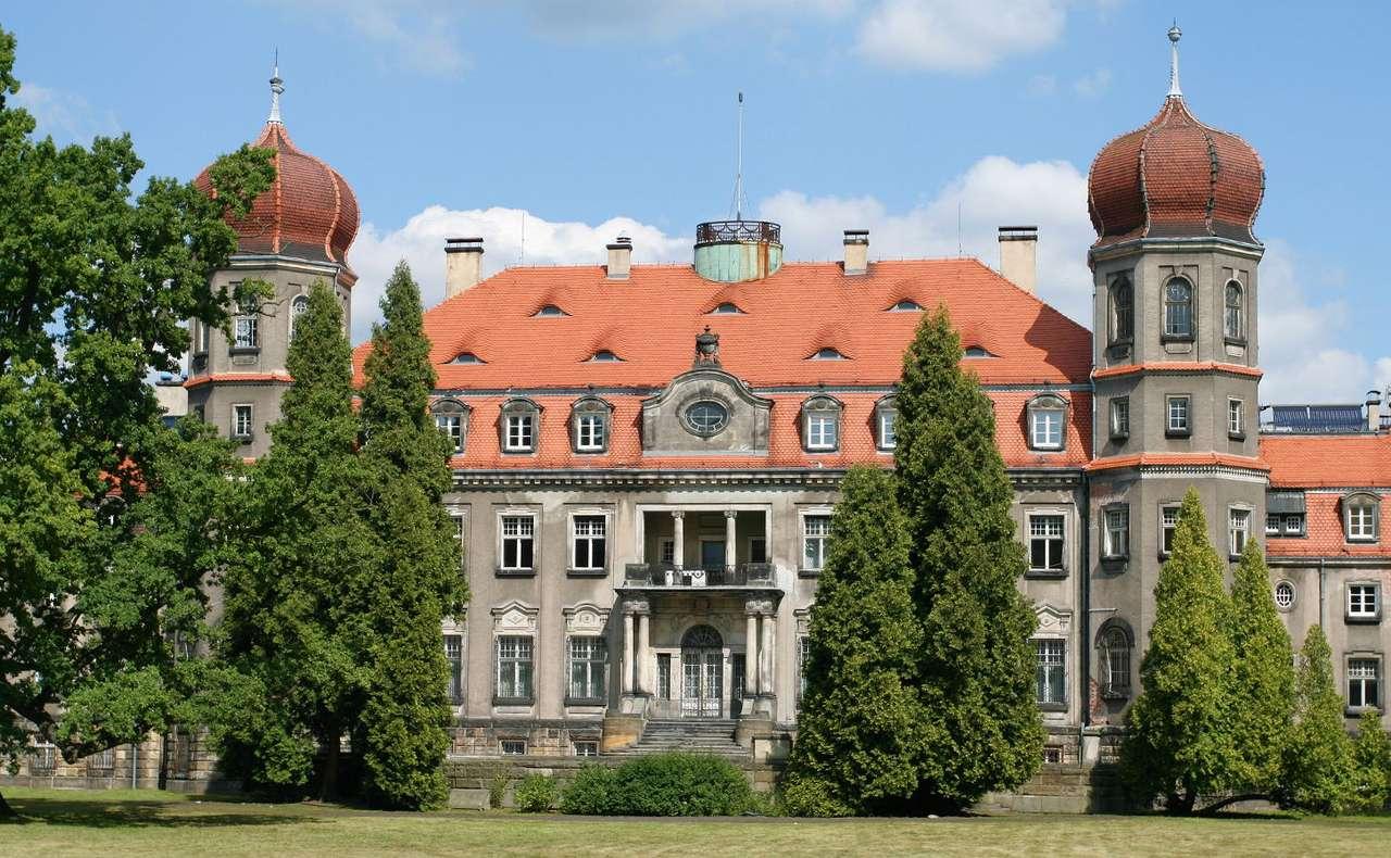 Pałac w Brynku - Pałac w Brynku to element zespołu pałacowo-parkowego, pochodzącego z przełomu XIX i XX wieku. Kompleks powstał na bazie pałacu, kaplicy i zabudowy gospodarczej otoczonej ogrodem botanicznym. Wz (12×7)