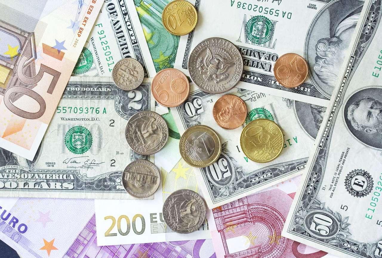Dolary i euro - Dolar (waluta Stanów Zjednoczonych) i euro (waluta obowiązująca w niektórych krajach Unii Europejskiej) to najważniejsze na świecie jednostki monetarne, w których dokonuje się rozliczeń finan (17×13)