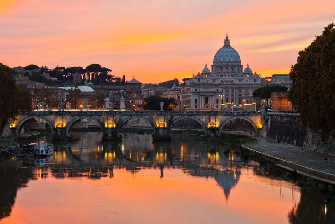 Panorama Rzymu z Bazyliką świętego Piotra (Włochy) - Bazylika świętego Piotra w Rzymie tradycyjnie jest uznawana za budowlę stojącą w miejscu ukrzyżowania i grobu jej patrona – szczątki pierwszej głowy Kościoła spoczywają w miejscu dzisiejs (7×5)