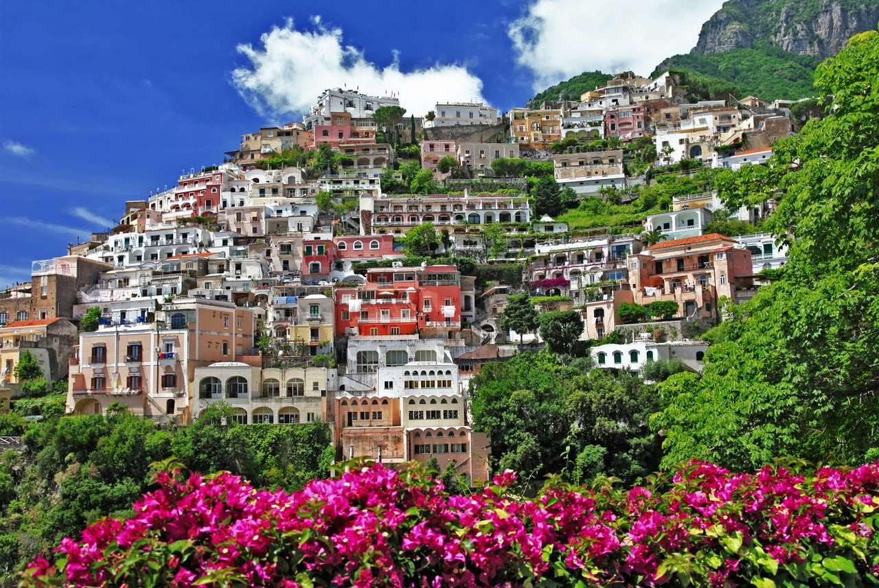Positano (Włochy) - Positano to miasteczko na wybrzeżu Amalfi we włoskiej prowincji Salerno. Według średniowiecznych legendowych przekazów to właśnie tutaj sztorm i burza zatrzymały piratów, którzy skradli cenn (12×9)