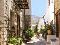 Malownicza uliczka na wyspie Hydra (Grecja) puzzle